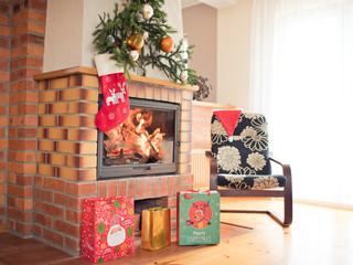 Living room with a fireplace with Christmas decorations and presents