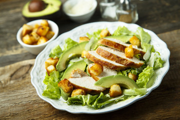 Grilled chicken Caesar salad with avocado