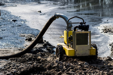 Photo of yellow pump for pumping out water