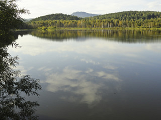 Autumn landscape: a forest lake surrounded by forest