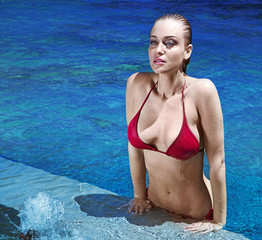 Sensual blonde releaxing during swimming