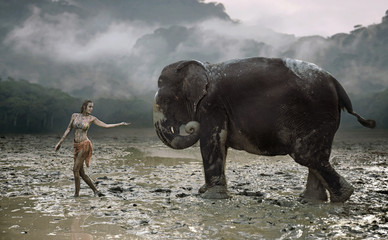 Conceptual portrait of a young tamer with an elephant