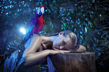 Senual lady with a colorful ara parrot