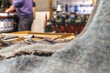 Historic woolen mill production background with Tweed