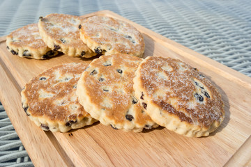 Welsh cakes on a wooden chopping board