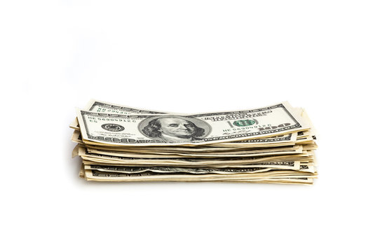 A stack of one hundred dollar bills on a white background.