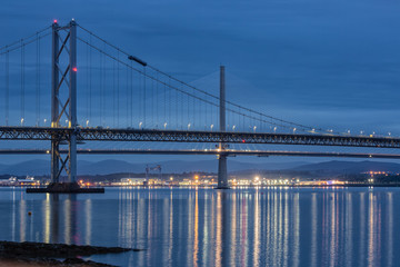Evening view at Forth Road Bridge and Queensferry Crossing over Firth of Forth near Queensferry in Scotland