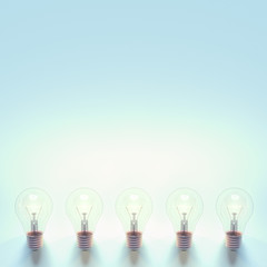 Light bulb on pastel blue minimal concept
