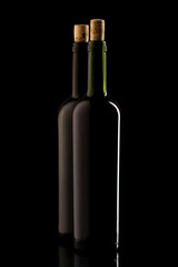 Wine bottles with cork and on black isolated background