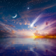 Glowing sunset with falling comet, rising crescent moon and stars