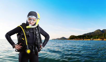 Female diver sportsman in wetsuit and diving gear