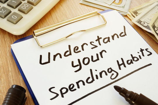 Understand your spending habits written on a clipboard.