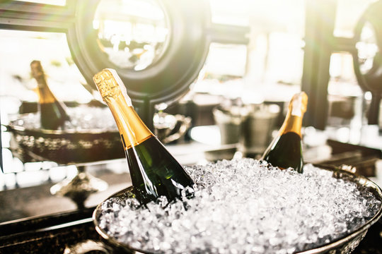 Champagne bottles in bucket with ice