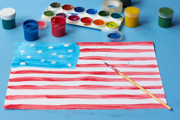 The child painted the American flag