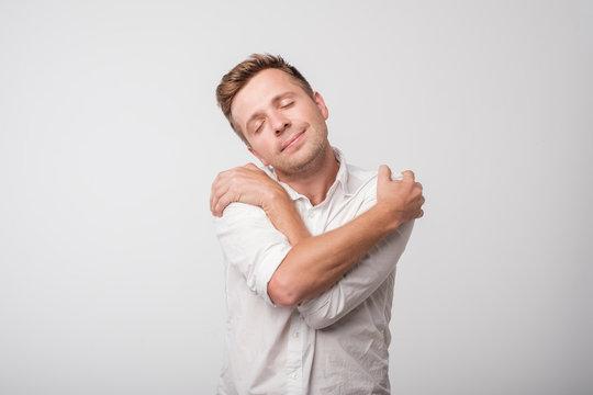 You do not need girlfriend if you can hug yourself. Concept of selfish feeling.