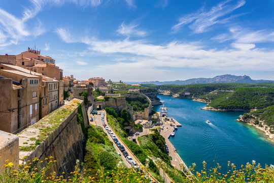 Landscape on Corsica island, beautiful view of Calvi town with castle on hill in summertime, France