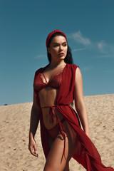 Girl in red lingerie outdoor