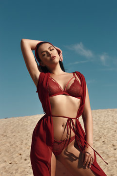 Girl in red lingerie outdoor dreaming