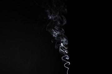 White smoky waves of smoldering aroma stick