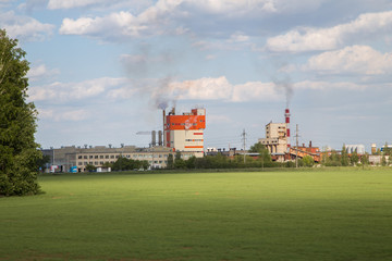 Factory plant limestone cement production buildings at the green landscape