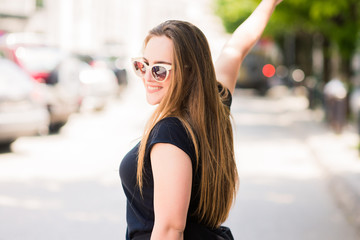 Cute Girl with sunglasses posing in the city