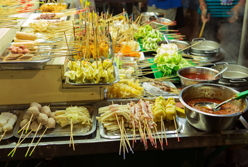 Asian street Food. People cooking, selling and buying Exotic Asian Food