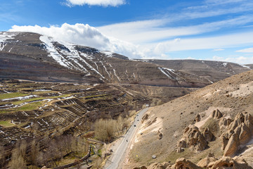 View of mountain landscapes and road to rock village Kandovan. Iran