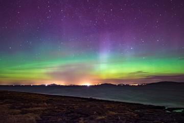 Northern lights aurora at seaside color Norway