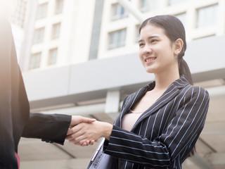 Businesswomen with insurance broker Shaking Hands In the outdoor