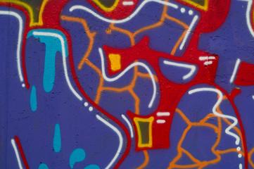 colorful graffiti on concrete background, concept of wall inscriptions, copy space, closeup