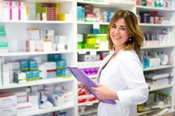 Woman customer with a folder in the pharmacy