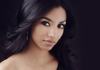 Attractive woman with long dark hair.