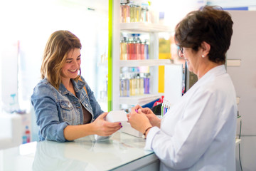 Pharmaceutical girl selling products to a customer