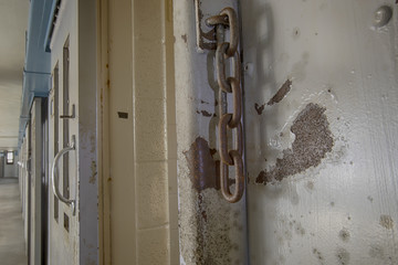 Rusty chains on prison cell door