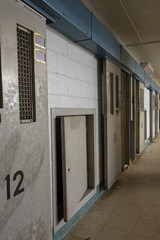 Row of open cells in abandoned prison