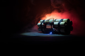 Image of a time bomb against dark background. Timer counting down to detonation illuminated in a shaft light shining through the darkness