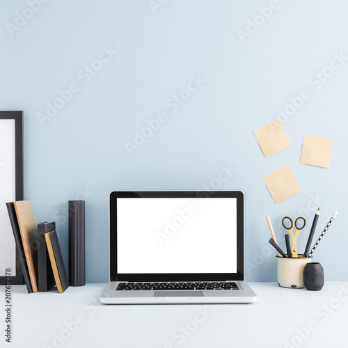 Laptop computer, office supplies, sticky notes