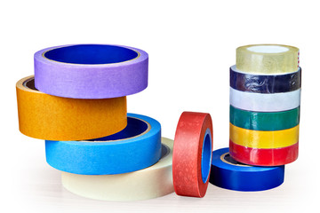 Coils of multi-colored adhesive tape for various purposes on white background.