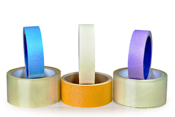 Several multi-colored rolls of duck tape, isolated on white background.