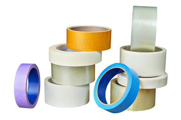 Multicolored duct tape in assortment folded of pile on white.