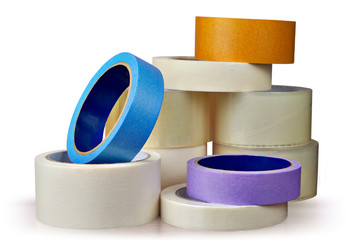 Adhesive tape in assortment, white background.