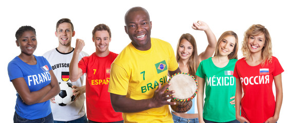 Brazilian soccer supporter with drum and fans from other countries