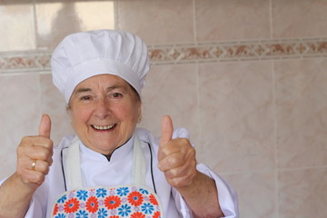 Senior chef giving thumbs up with copyspace