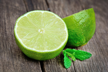 Fresh lime with mint on old table