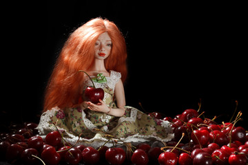 Doll and cherry