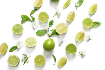 Composition with fresh ripe limes on white background, top view