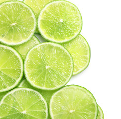 Fresh sliced ripe limes on white background, top view