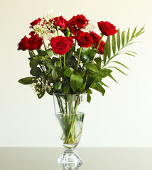 Bouquet of red roses on the table