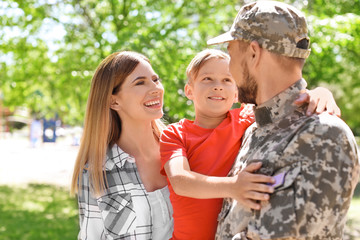 Male soldier with his family outdoors. Military service