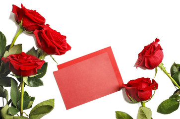 Fresh red roses and blank paper for notes on white background with copy space